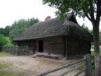 Lithuanian log cabin with thatched roof